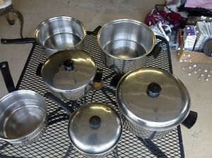 Assorted stainless steel pots,