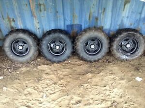 Perfect condition Maxxis tires. And Yamaha special edition rims