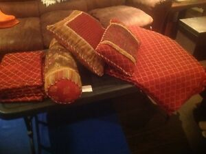 Decorative pillows with throw and curtains