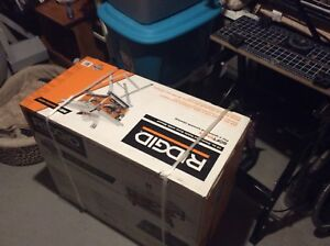 Brand new rigid table saw with stand