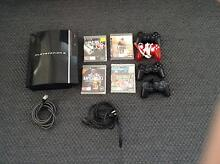 Sony Playstation 3 charcoal black, 4 controllers and 4 games Murarrie Brisbane South East Preview