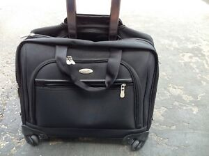 NEW LAPTOP BAG WITH IN LINE ROLLERS