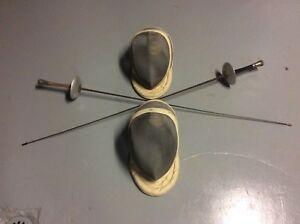 Vintage fencing foils and masks ..... swords