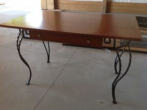 Table with solid wrought iron legs