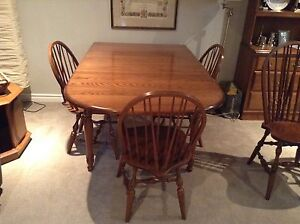 Large solid oak drop leaf  table with 6 chairs