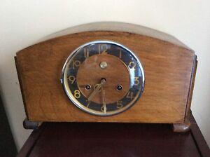 Belle horloge de foyer antique