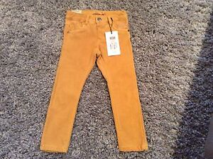 Brand new, X-slim mustard pants for 3-4 years