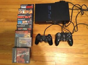 PlayStation 2 + 2 controllers + 8 games