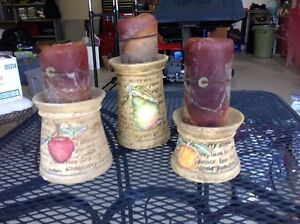 Set of three pottery candle holders ,in EUC, NOCHIPS