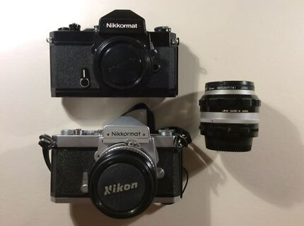 2 x Nikkormat SLR cameras plus 24mm and 50mm lenses
