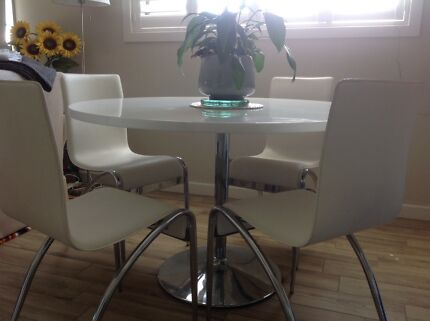 Round, White laminex table, with 4 leather chairs