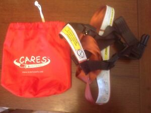 CARES airplane travel harness/safety restraint system