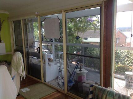 4 door slider, with screens, tinted, excellent condition$400