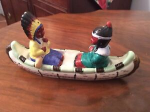 Vintage First Nation Couple in a Canoe Salt and Pepper shakers