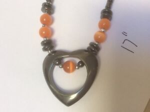 Costume necklace - metal with orange beads