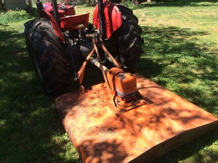 Small farm tractor and slasher