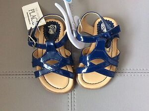 Baby girl size 4 (toddler) navy sandals- new with tags.