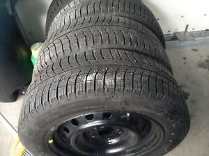 Almost New 205 60R 16 Michelin X Ice winter tires and rims
