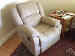 Recliner armchair almost new.