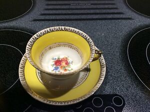 Antique tea cup and saucer with gold trim