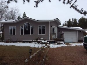2500 sq ft Acreage, 3km west of P.A. Priced to sell ! Only 375k