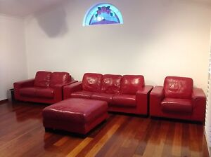 Red leather lounge from nick scalli Macquarie Links Campbelltown Area Preview