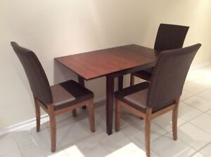 NEW DROP LEAFS TABLE AND 3 chairs