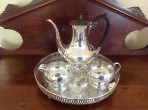 Silver coffee pot with cream and sugar and silver tray