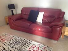 Red leather sofa with Crome feet. Secret Harbour Rockingham Area Preview