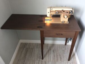 Vintage sewing machine and table