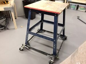 Power tool stand with adjustable mobile base