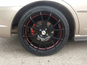 4x100 17inch Fast Venom Rims with almost new 205/40/r17 tires