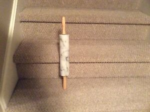 Marble rolling pin with wood handles. White with grey veining.
