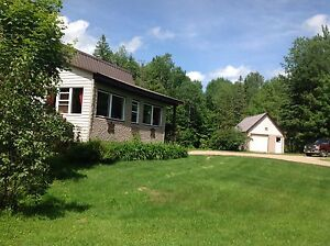 COUNTRY RETREAT ON 50 ACRES IN CHISHOLM TOWNSHIP