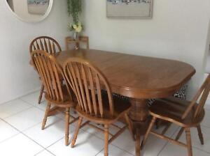 Extendable Dining Table with 8 Chairs. Ideal for larger families.