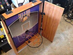 Basketball hoop in cabinet.  It can hook over a door
