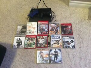 PlayStation 3 with two controllers and 12 games