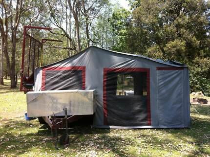 Heavy duty camper with boat racks