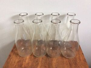 Old milk bottles for sale 12 large and 3 small