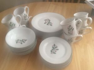 4 place setting of christmas dishes $25