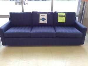 Blue Couch on Wheels