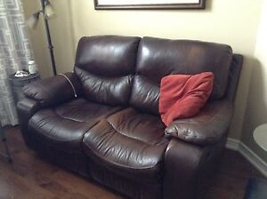Leather reclining love seat.