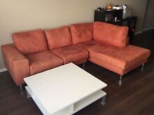 Red  suede sofa  with a coffee table Rockdale Rockdale Area Preview