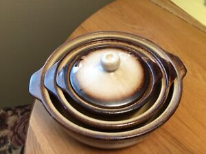 Pottery  casseroles with lids.