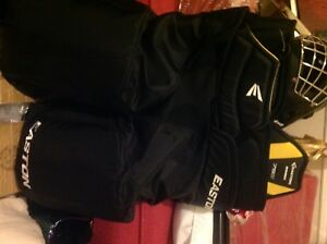New Easton hockey gloves and shoulder pads plus hockey pants