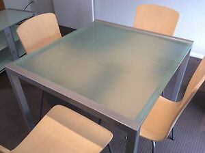Glass-top dining table with four timber veneer chairs Yowie Bay Sutherland Area Preview