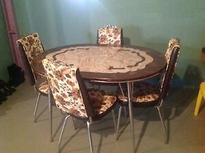 Chrome  Table with 4 Chairs and Extension leaf.