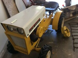 Cub Cadet 100 (1965) garden tractor, plow and snow blower