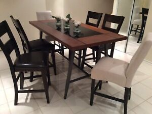 Counter high table and 6 chairs with wine rack underneath