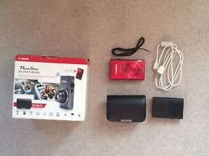 red canon Powershot ELPH130Is with leather case